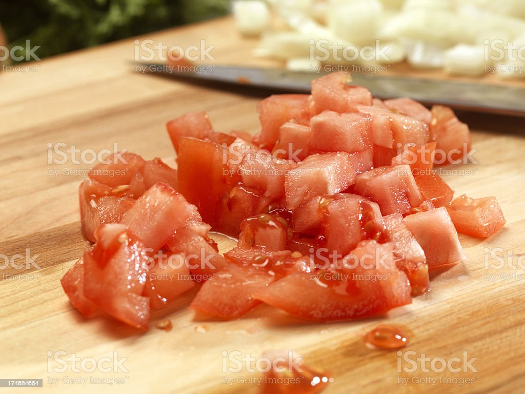Diced Tomatoes on Cutting Board stock photo