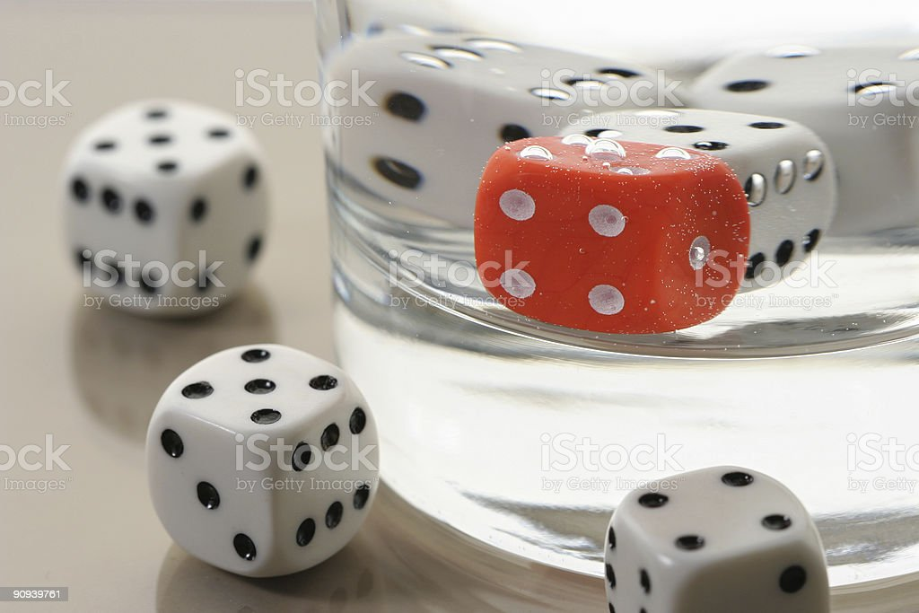 Dices in glass of water royalty-free stock photo