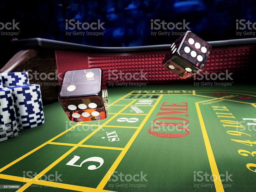 dices on craps table at casino stock photo