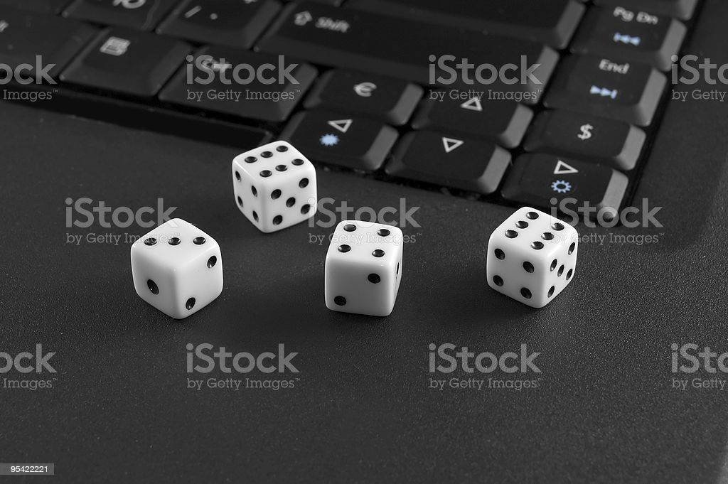 Dices with computer royalty-free stock photo