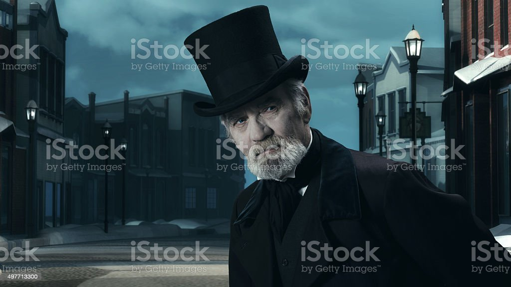 Dickens Scrooge Man in Old Winter Street. stock photo