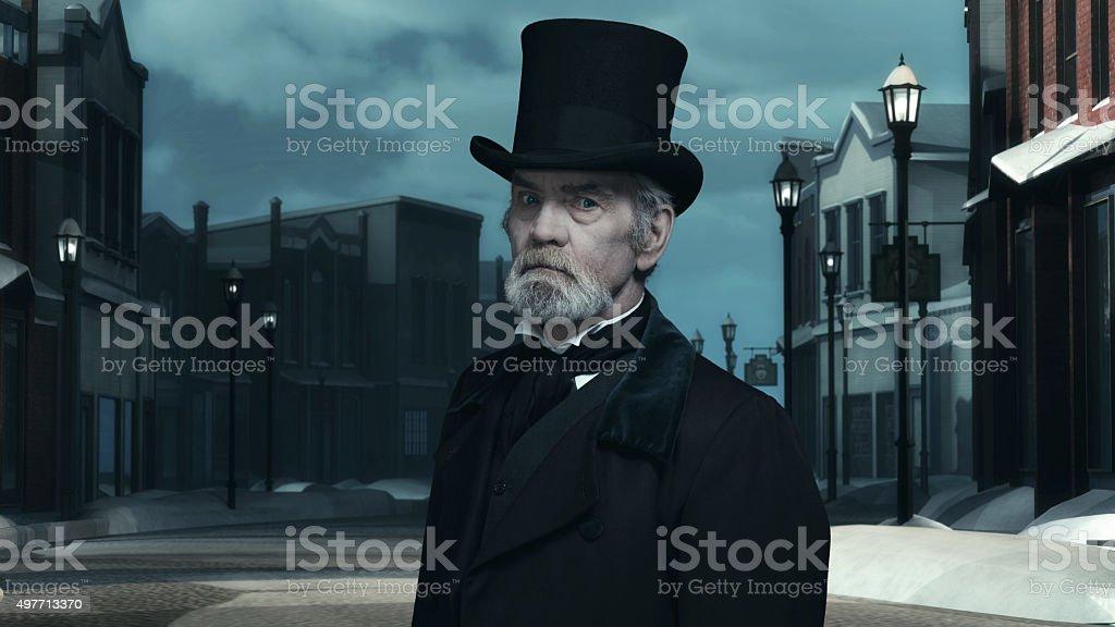 Dickens Scrooge Man in Old Winter Street. stock photo