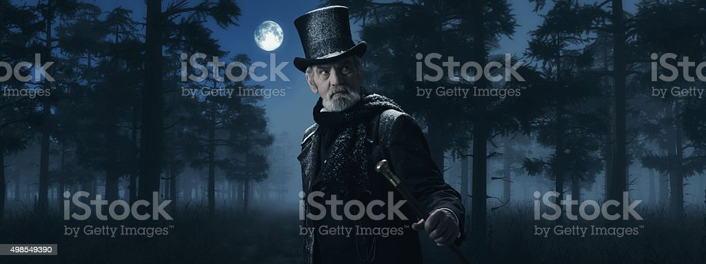 Dickens Scrooge Man with Cane in Misty Winter Forest. stock photo