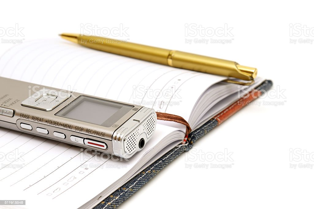 Dictaphone, notepad and ballpen stock photo