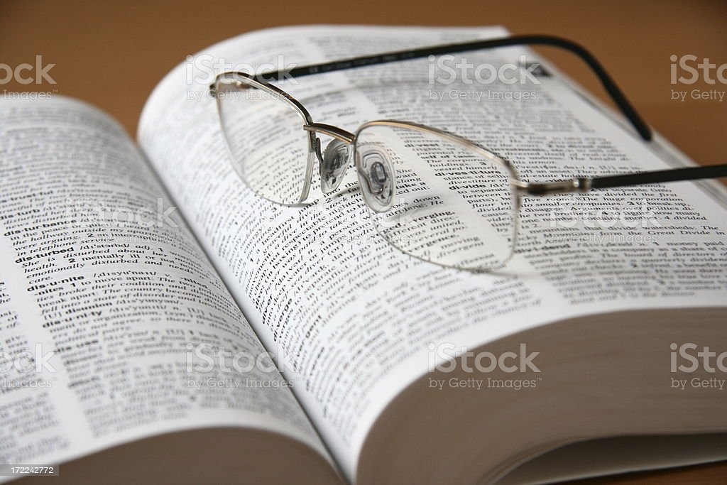 Dictionary and Eyeglasses royalty-free stock photo