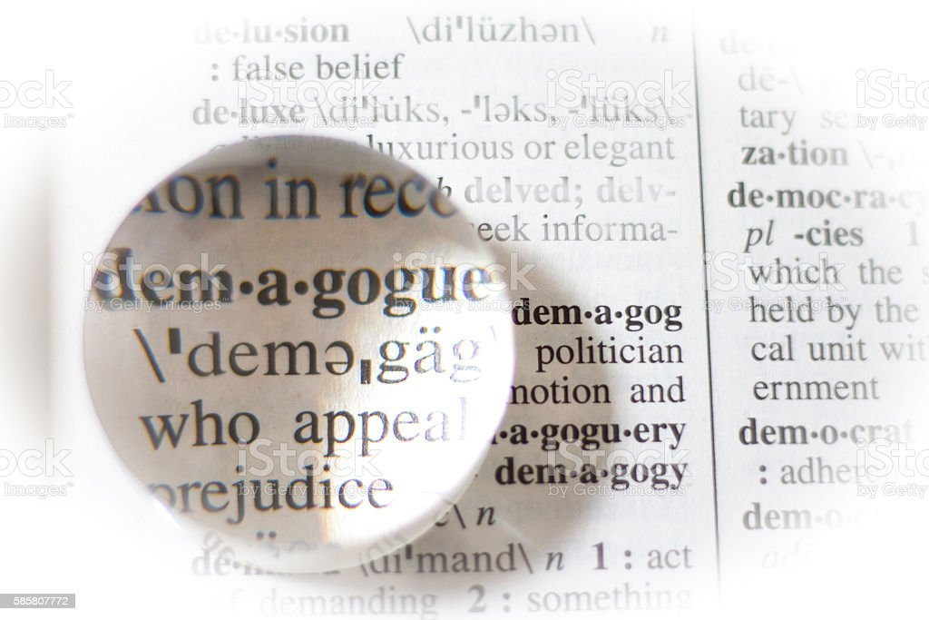 Dictionary Definition (With Magnifying Glass): Demagogue stock photo
