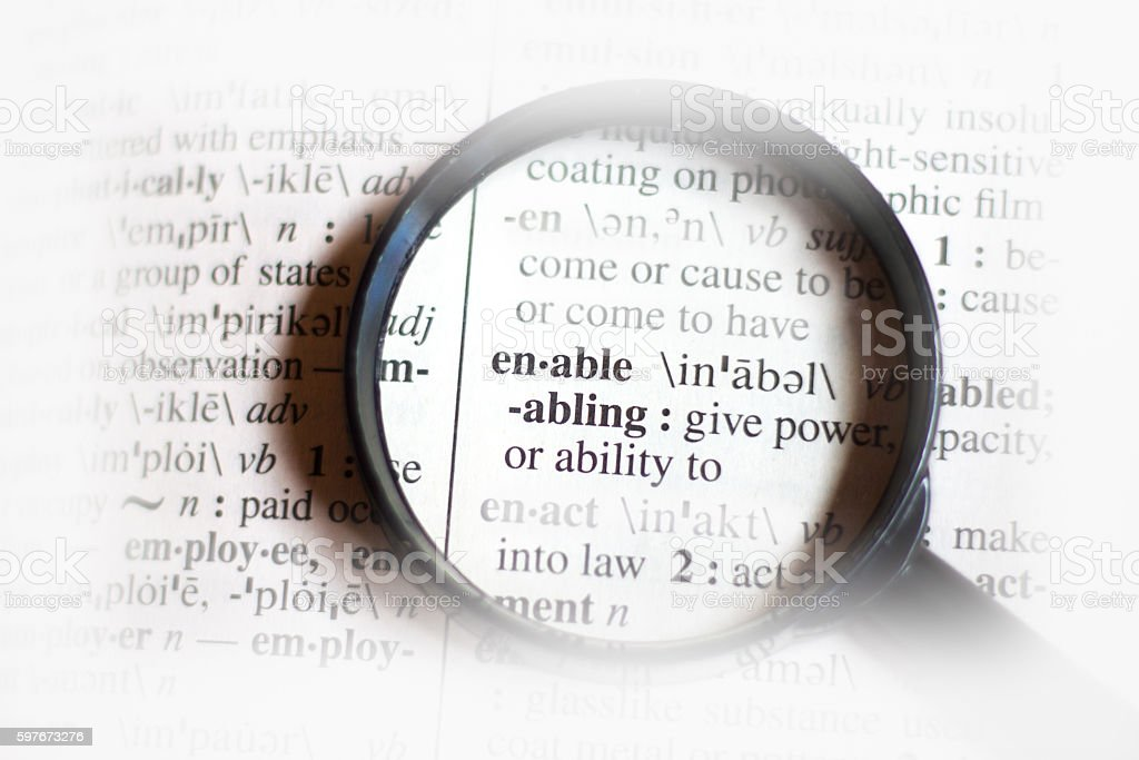 Dictionary Definition (With Magnifying Glass): Enable stock photo