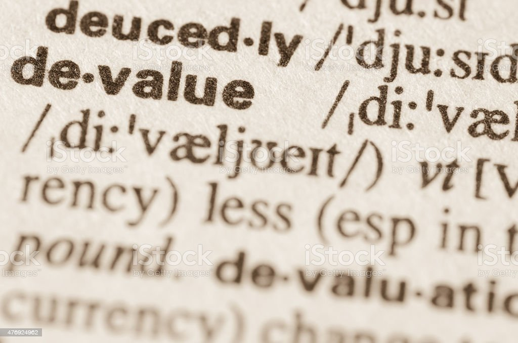 Dictionary definition of word devalue stock photo
