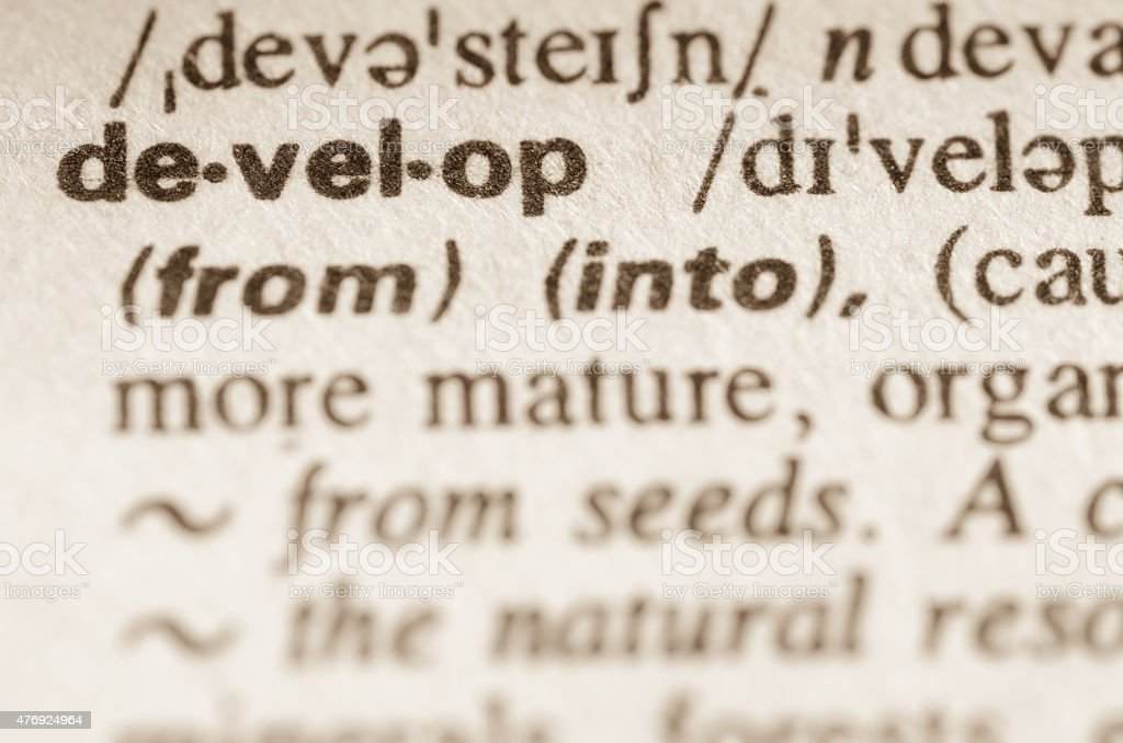 Dictionary definition of word develop stock photo