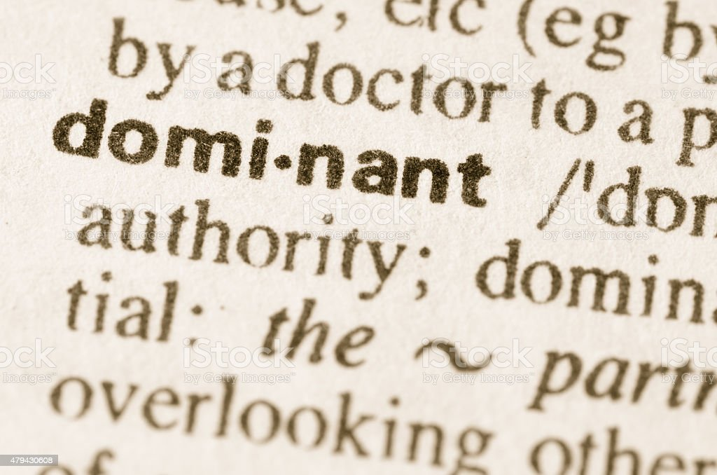 Dictionary definition of word dominant stock photo