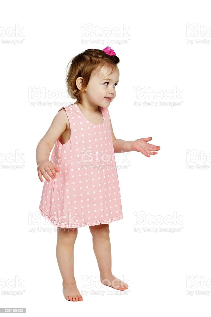 I didn't do it! Cute toddler girl giggles and shrugs stock photo