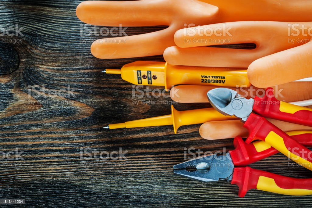 Dielectric gloves electric tester insulated cutting nippers plie stock photo