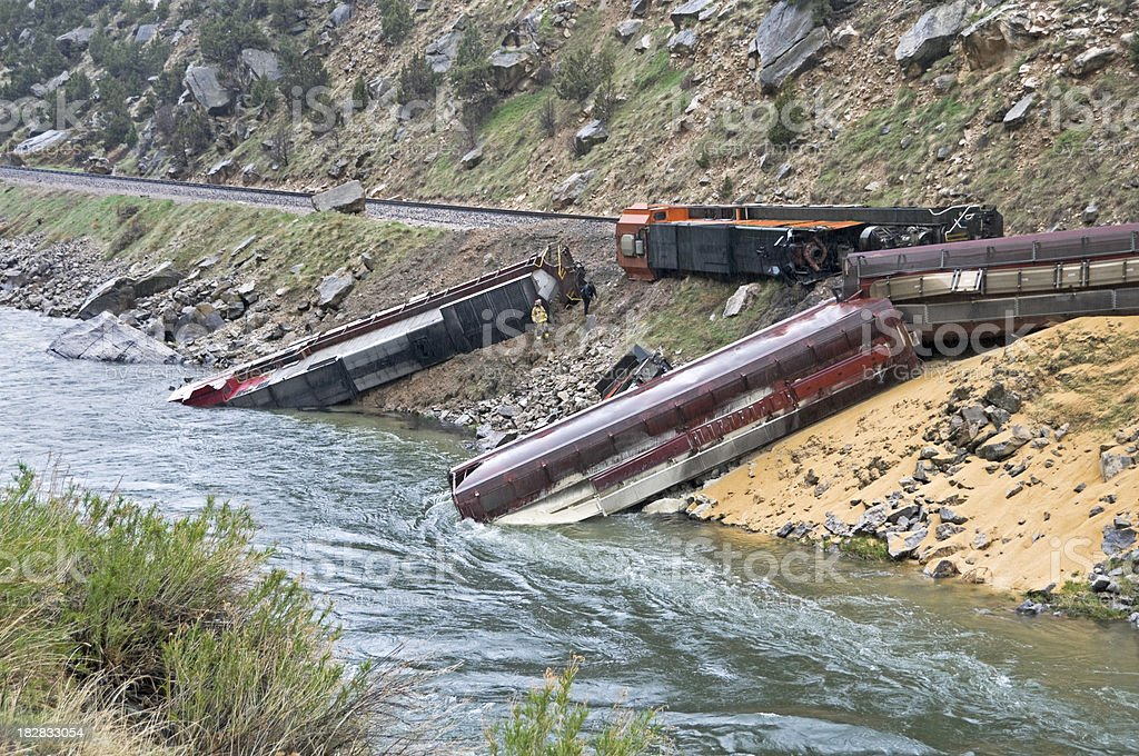 Diesel fuel leaking into river from locomotive stock photo