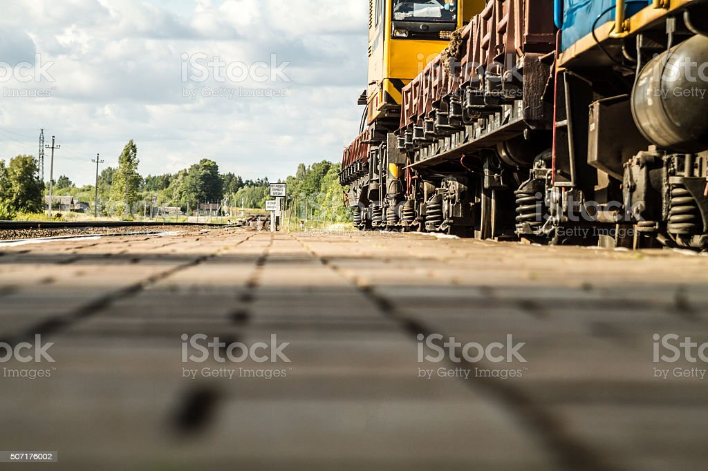 Diesel locomotive is at a small station. stock photo