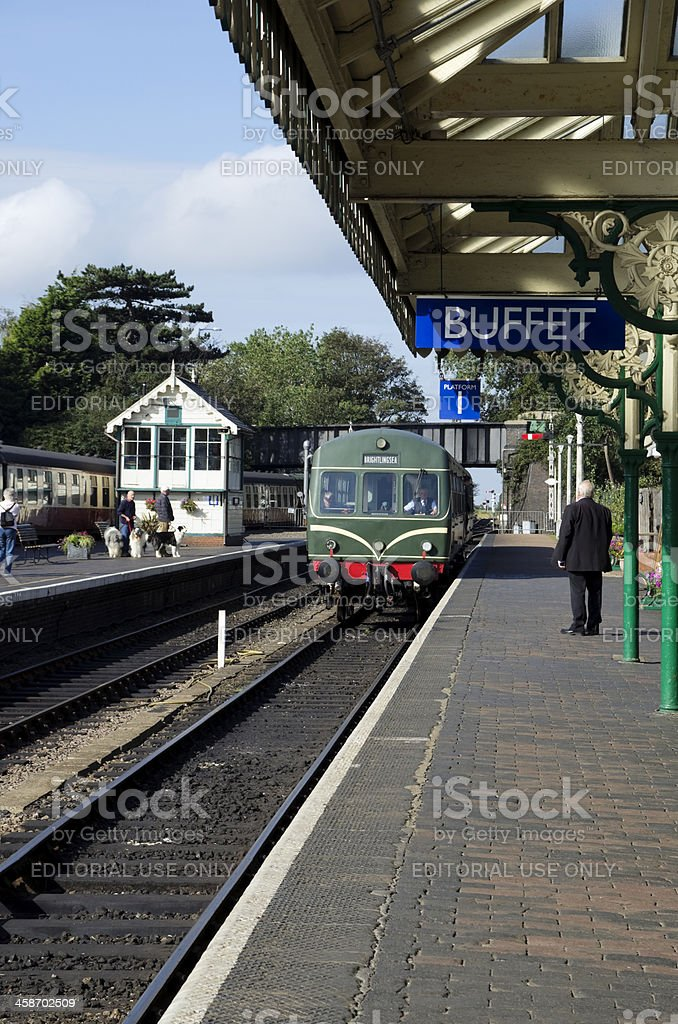 Diesel train approaching Sheringham railway station stock photo