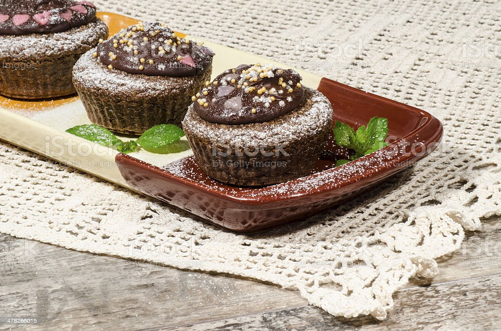 Diet chocolate cupcakes on yeliow rectangular plate royalty-free stock photo