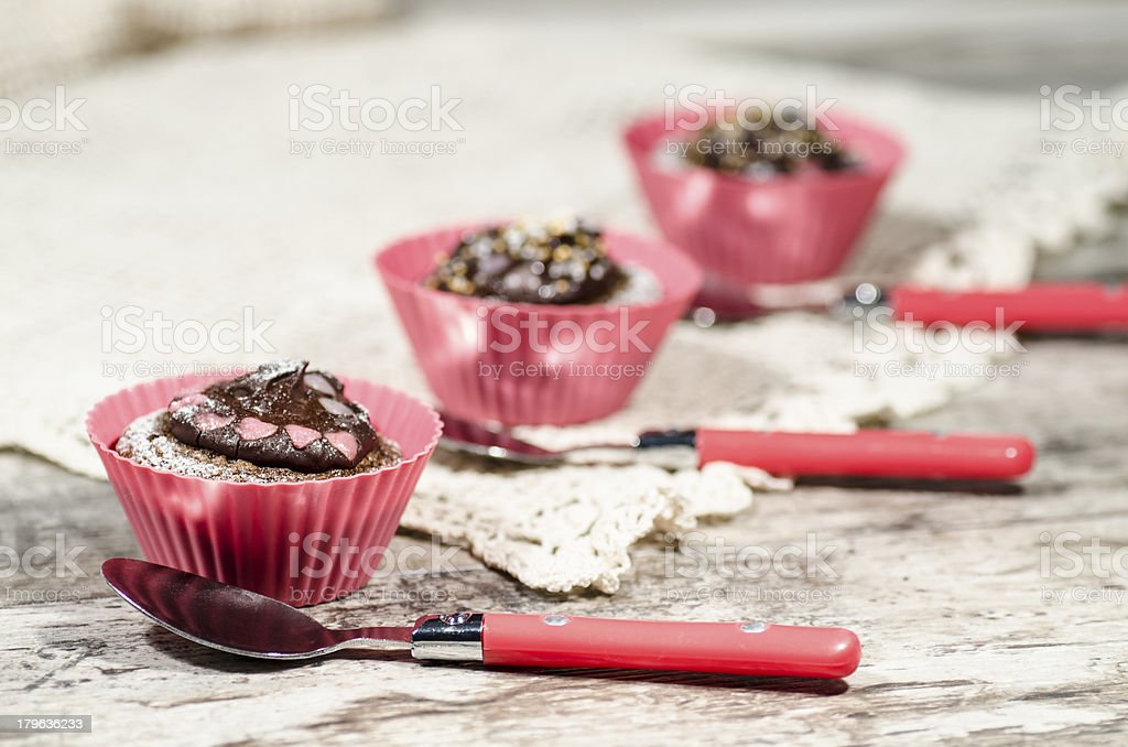Diet chocolate cupcakes with spoons royalty-free stock photo