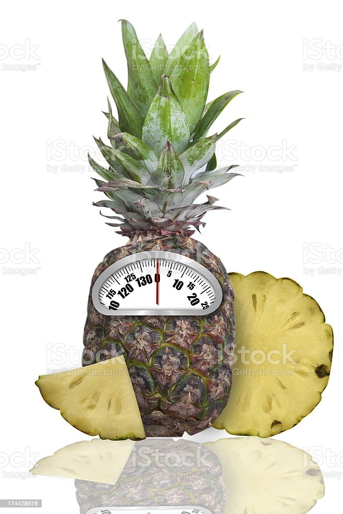 Diet concept. Ananas and scales. stock photo