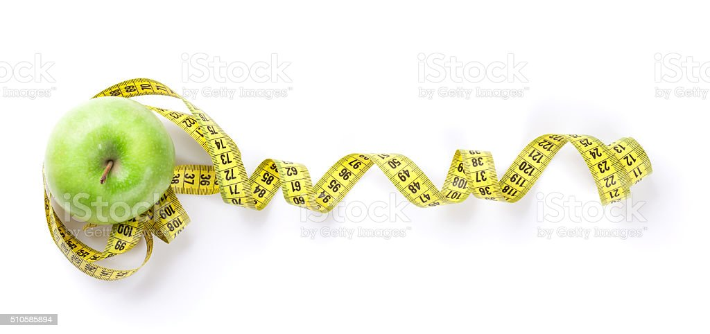 Diet concept. Apple and tape measure stock photo
