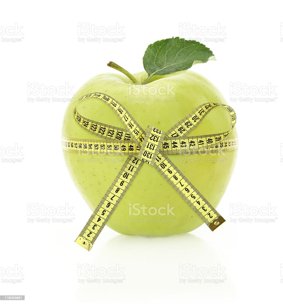 Diet concept. Apple with measuring tape stock photo