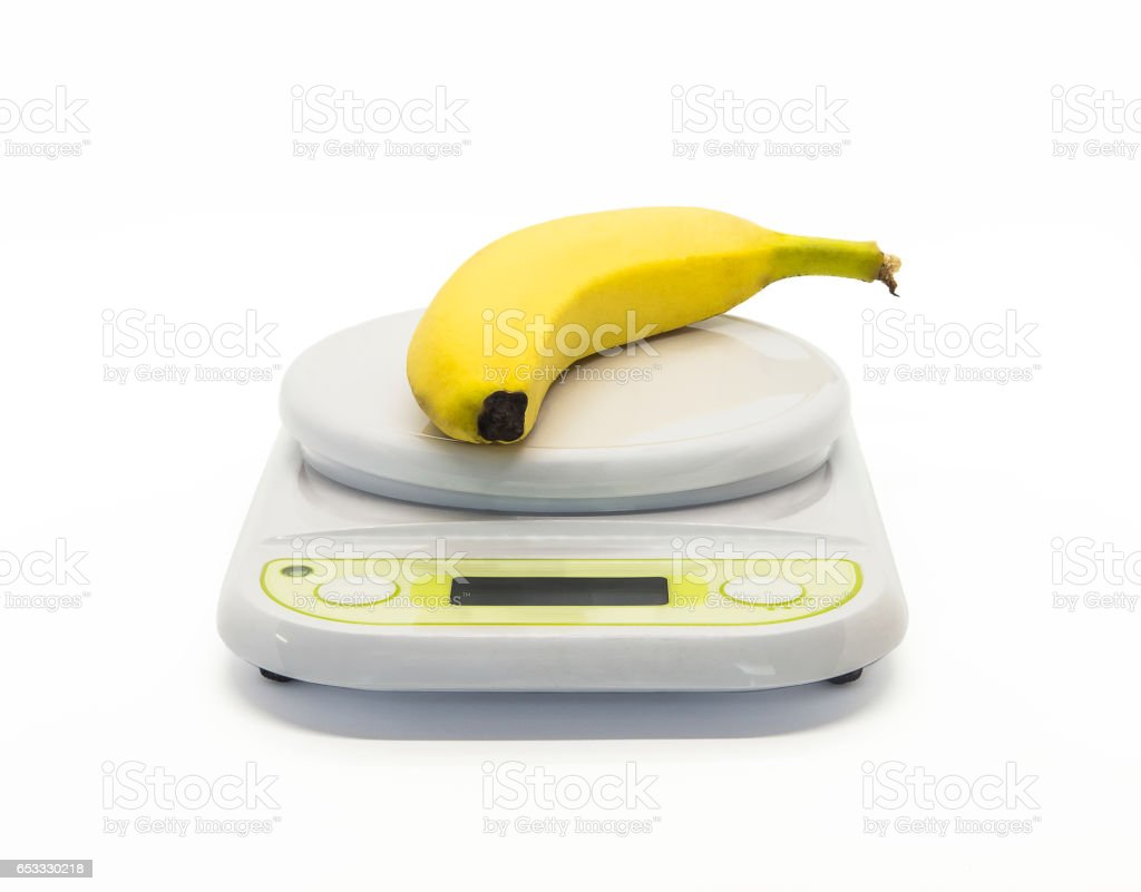 Diet concept, banana and weight scale, isolated on white background stock photo