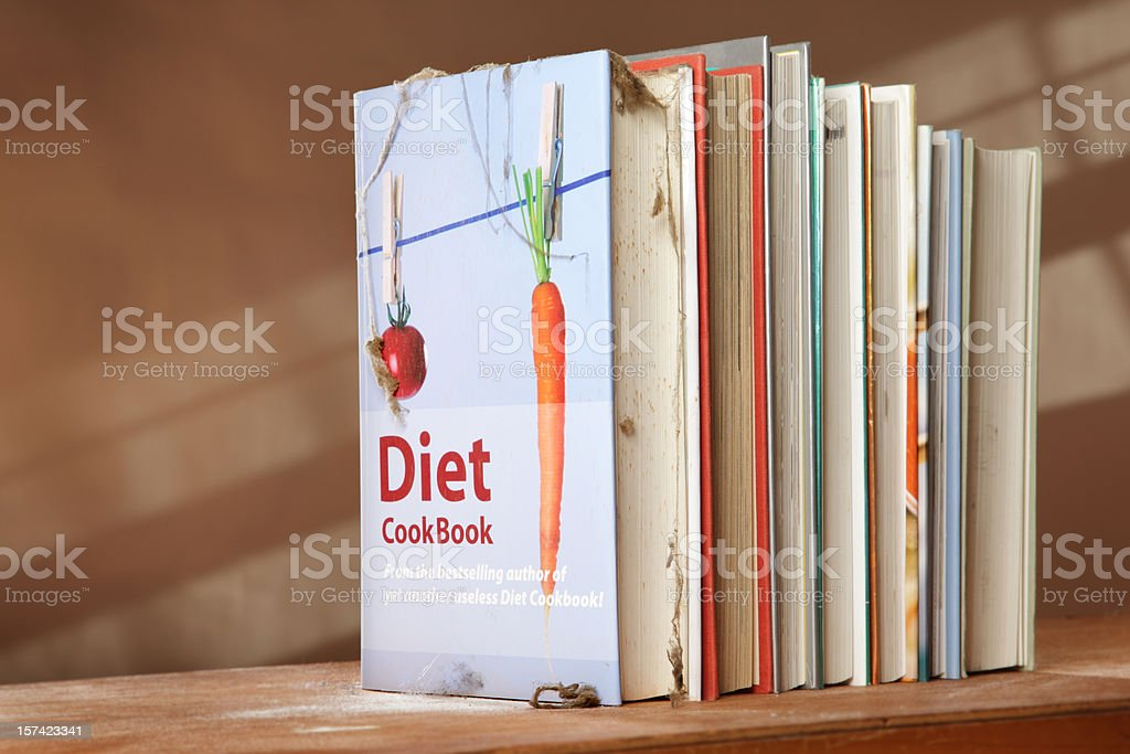 Diet cookbook on shelf with other books stock photo