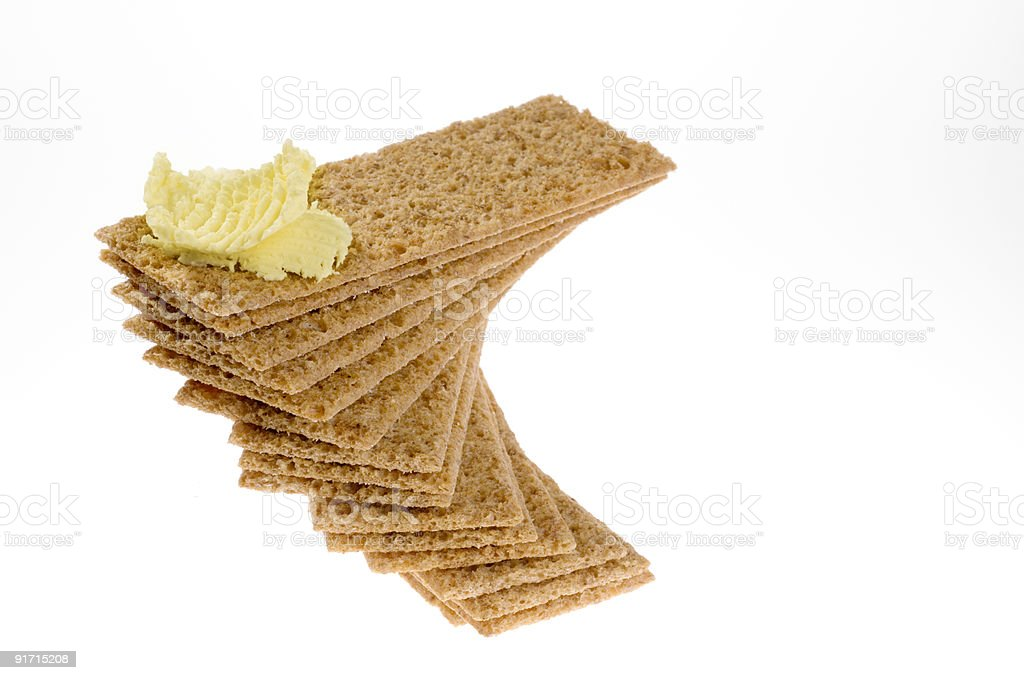 Diet crackers with butter over white. royalty-free stock photo