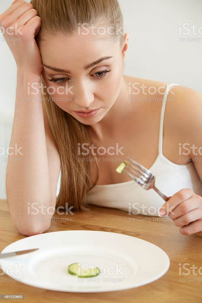 Diet. Dieting concept. Healthy Food. Beautiful Young Woman eats stock photo