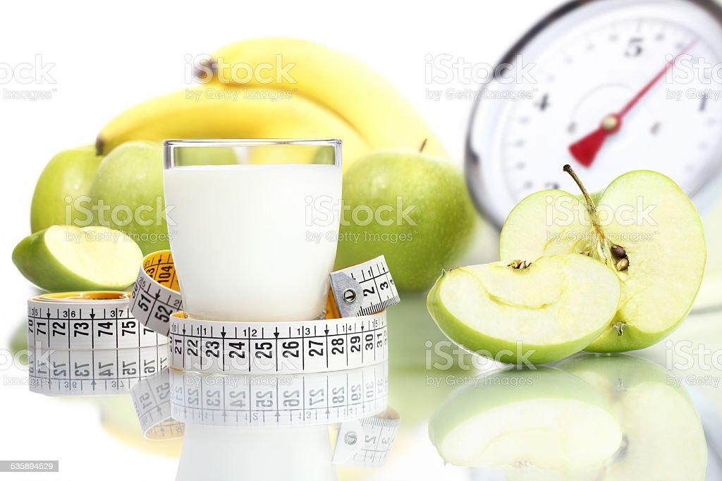 diet food milk glass, fruit Apple meter scales stock photo