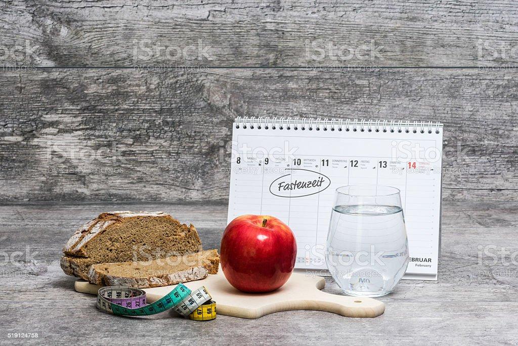 Diet Meal Grey Background with Calendar (Fastenzeit) stock photo
