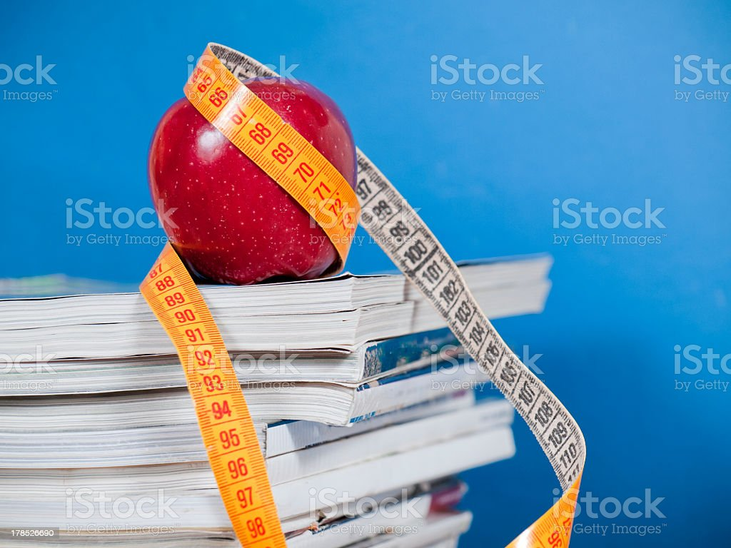 Diet Measurement On Magazines royalty-free stock photo