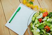 Diet plan, menu or program, tape measure and diet food.