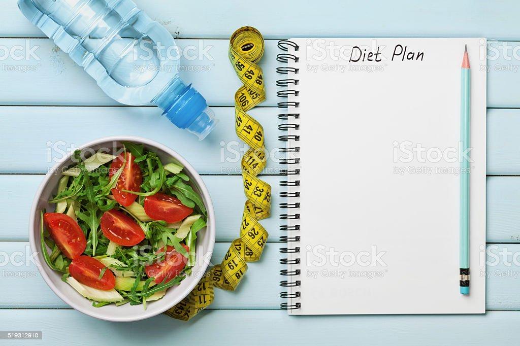 Diet plan, menu or program, tape measure, water, diet salad stock photo