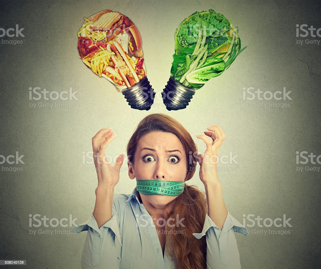 Diet restriction stress. Frustrated woman with measuring tape around mouth stock photo
