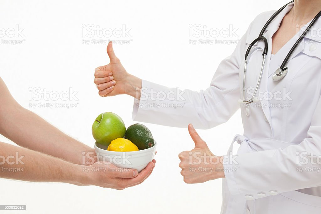 Dietarian approving fresh fruits stock photo