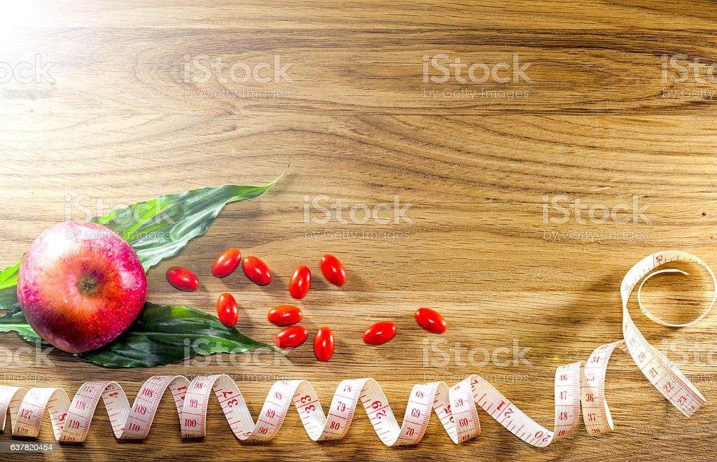 Dietary pills vie centimeter. The concept of diet, health stock photo