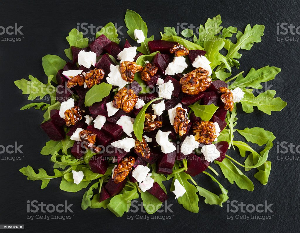 Dietary salad of beets. Black stone background, top view. stock photo
