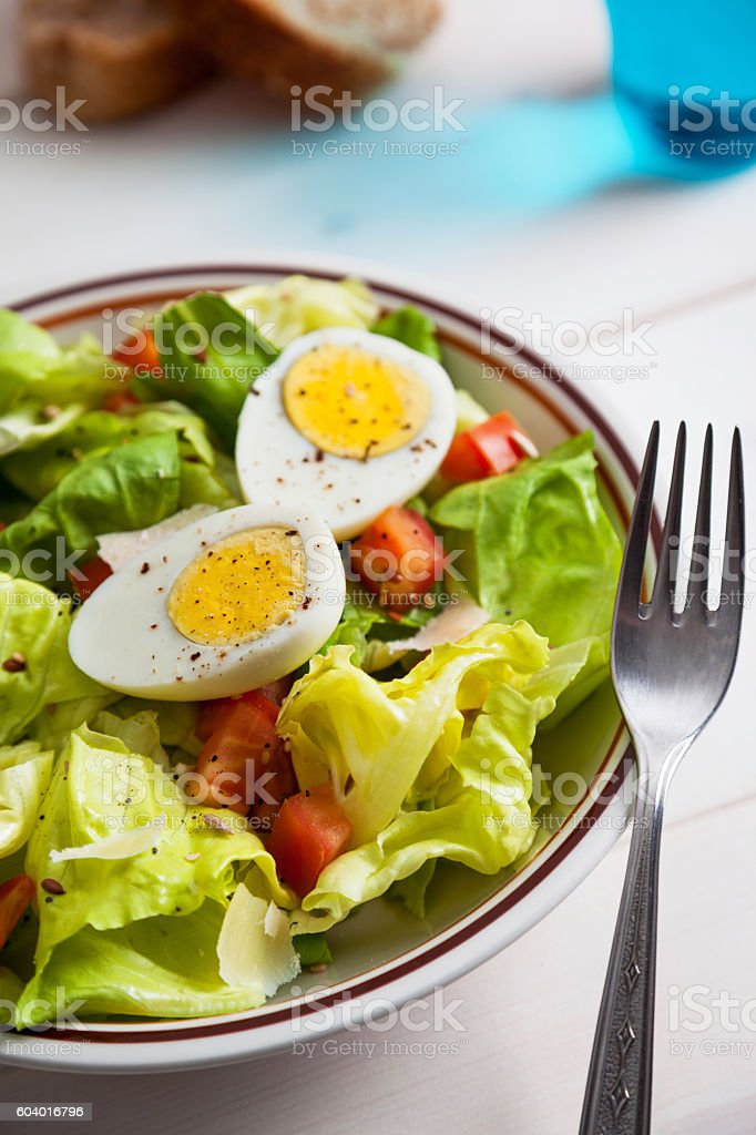 dietary salad with boiled eggs and seeds stock photo