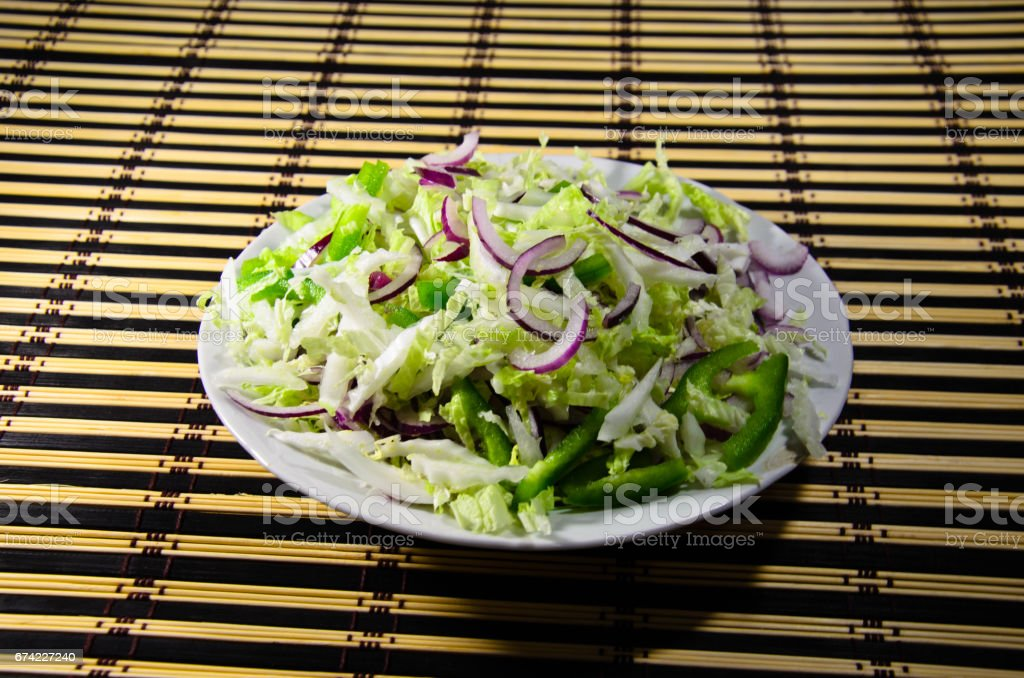 Dietary salad with chinese cabbage and onion stock photo