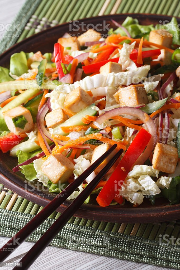 Dietary salad with tofu and fresh vegetables vertical stock photo