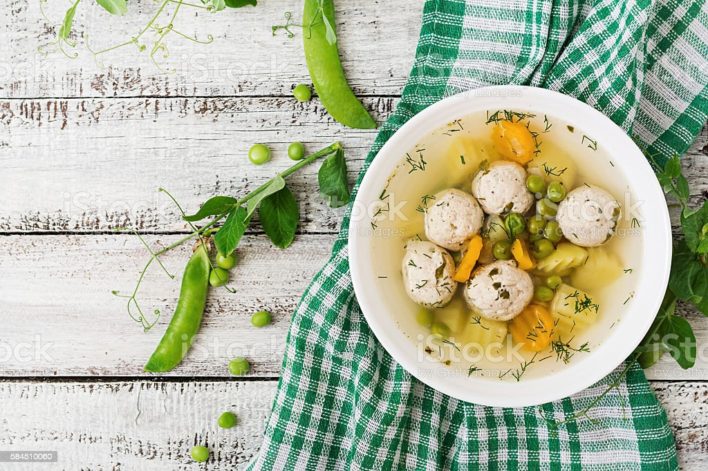 Dietary soup with chicken meatballs and green peas stock photo