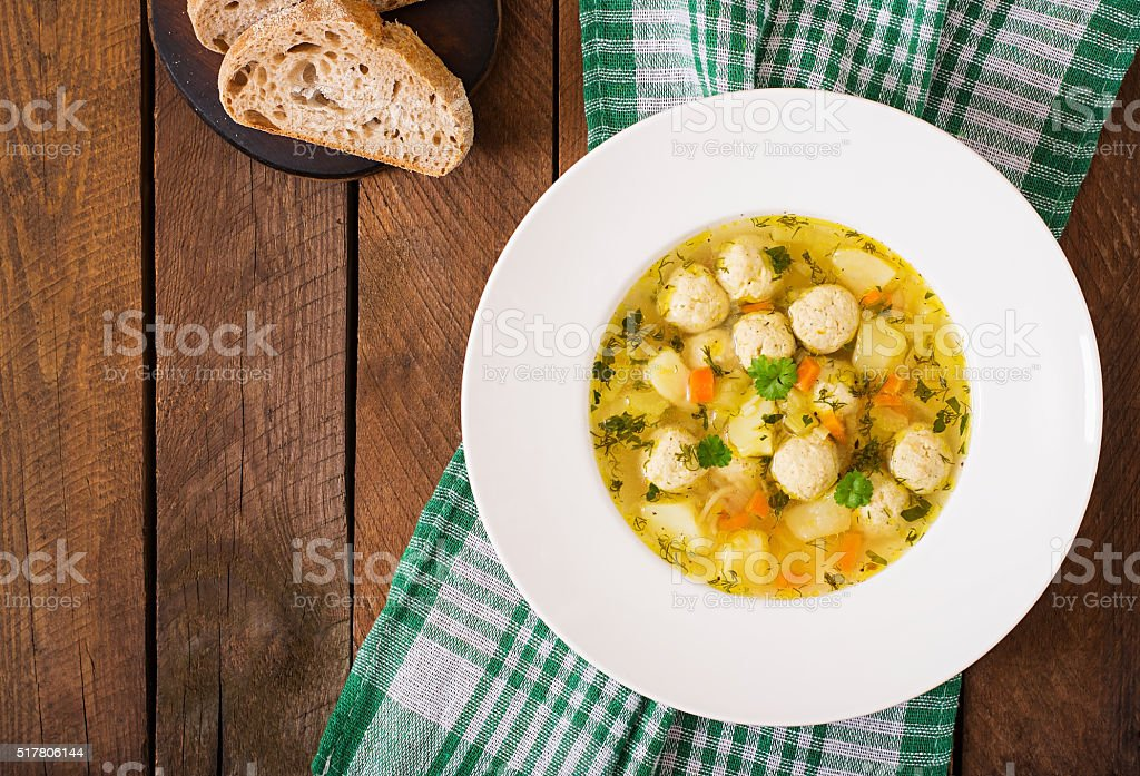 Dietary soup with chicken meatballs and stalks of celery. stock photo