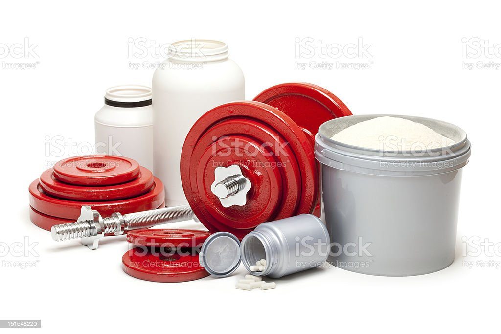Dietary supplements and steel dumbbells for body building royalty-free stock photo