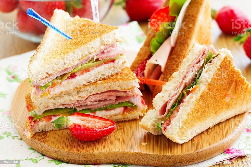 Dietary turkey sandwich and strawberry. stock photo