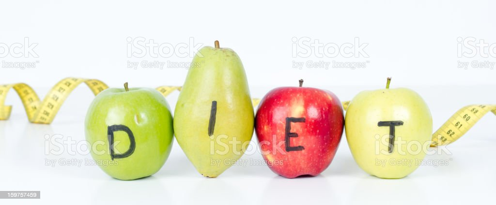Dieting Concept Fruit with Measuring Tape on White Background royalty-free stock photo