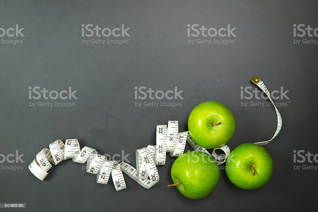 Dieting concept using green apples stock photo