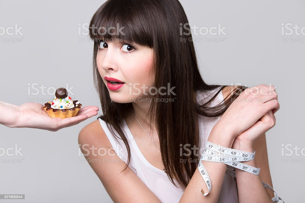 Dieting woman got caught while trying to eat cake stock photo