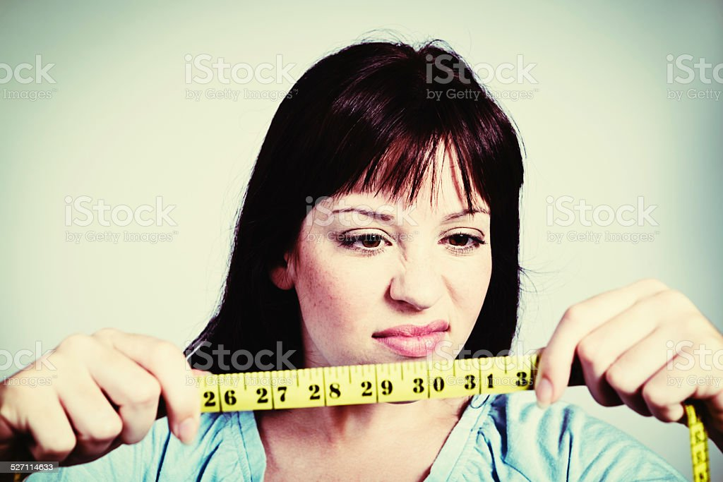 Dieting's a waste of time; I haven't lost an inch! stock photo