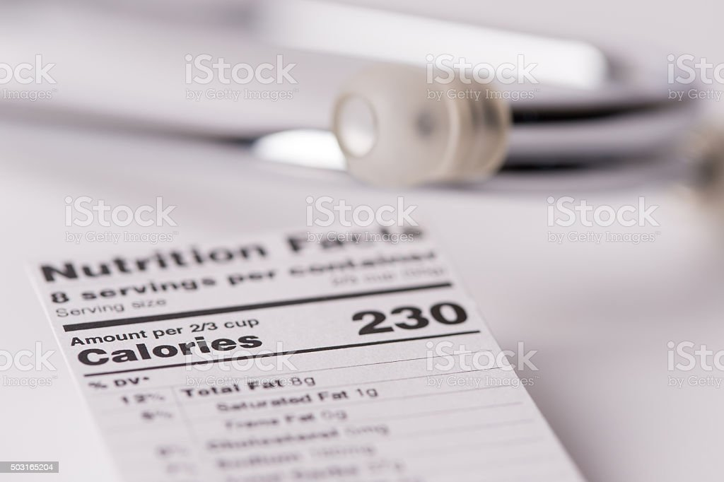 Dietitian and Healthy Eating Concept: Nutritional Label with Stethoscope stock photo