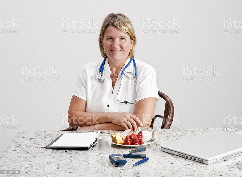 Dietitian, doctor or nurse with diabetes devices and food stock photo